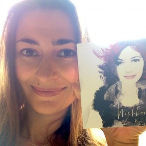 Image showing Manchester musician Zoe Kyoti holding her latest CD, Wishbone. Copyright Zoe Kyoti - Official Site