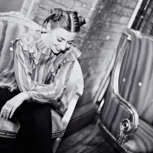 Black and white image - Manchester musician Zoe Kyoti sitting in ornate chair - Copyright Zoe Kyoti - Official Site
