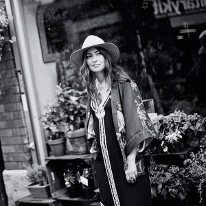 Black and White picture of Zoe Kyoti outside a florists. Copyright Zoe Kyoti - Official Site