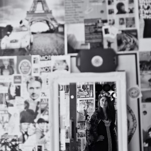 Black and white picture of Manchester singer-songwriter Zoe Kyoti in a mirror - Copyright Zoe Kyoti - Official Site