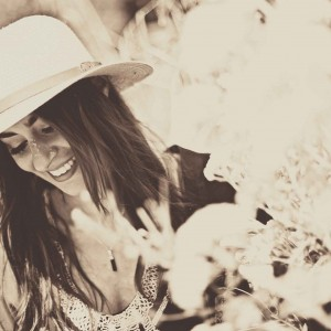 Picture of Manchester musician Zoe Kyoti wearing a hat and smiling. Copyright Zoe Kyoti - Official Site