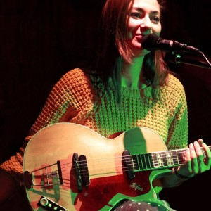 Image showing singer-songwriter Zoe Kyoti live. Copyright Zoe Kyoti - Official Site
